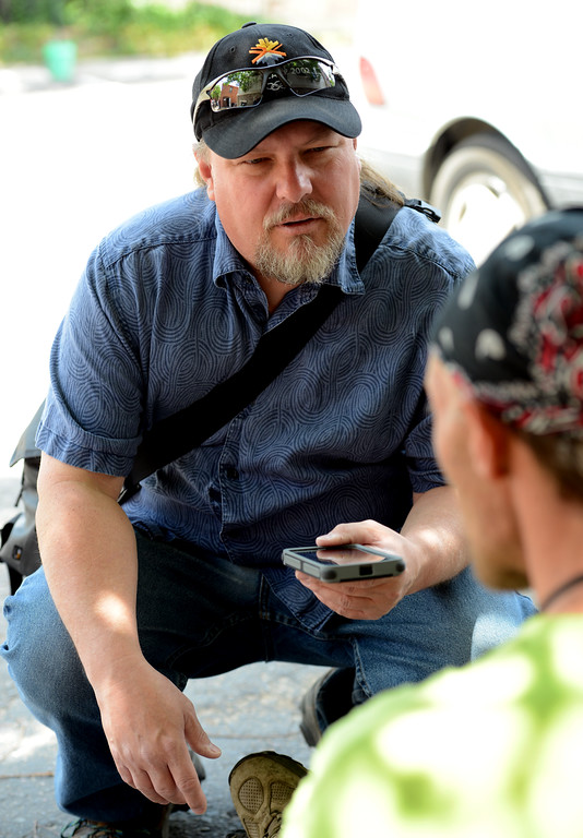 Mike Homner, of Facing Homelessness Boulder, interviews John Bingham outside the Carriage House in Boulder on Friday. Bingham describes himself a homeless. Paul Aiken Staff Photographer June 3, 2016